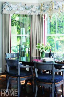 The breakfast nook conjures memories of the couple's California home; the owners chose a table and chairs similar to what they had out West, and repurposed a Pierre Frey rooster-print for the valances.