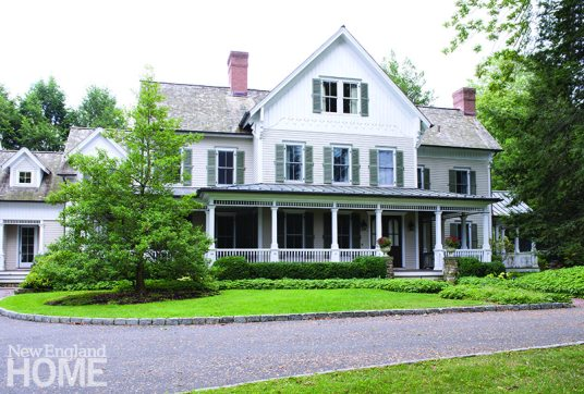 Built in 2000, the grand neo-Victorian house, with an inviting wraparound porch, sits within walking distance of town.