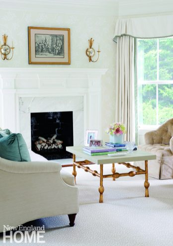 An elegant sitting room transforms the master suite into a private sanctuary.