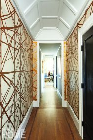Kelly Wearstler's vibrant Channels wallpaper for Lee Jofa brings big drama to the small entry hall.