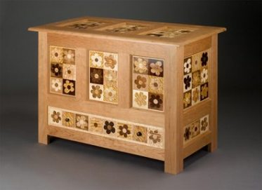 parquetry chest of traditional quilt pattern inspired by massachusetts hadley chests of 18th century.