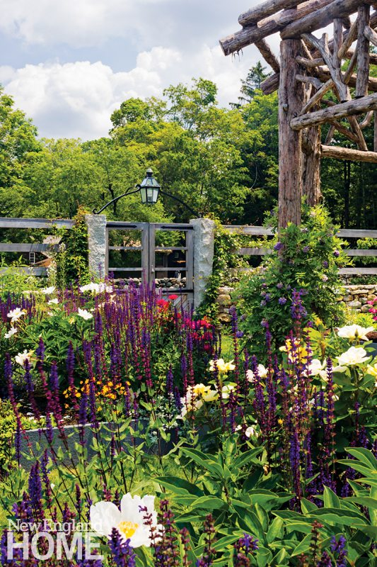 To fulfill the owner's request for maximum color and fragrance, the beds are heavily planted.