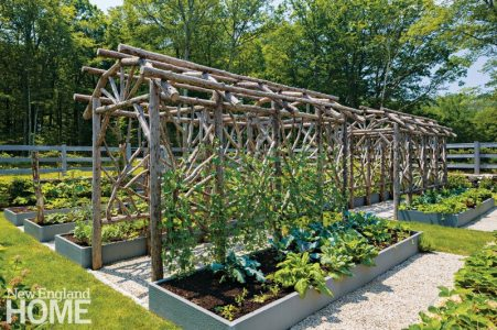 The handsome, rustic twig arbors are sturdy enough to support a wide roster of vegetables. To ease maintenance, the grassy paths partitioning the garden and running along the garden's perimeter are wide enough to mow.