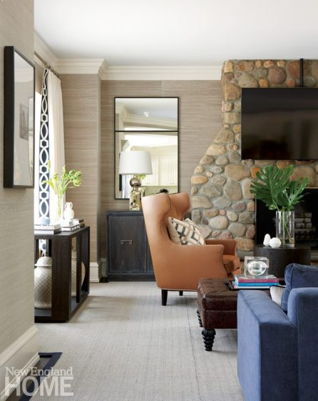 Family room with stone fireplace and leather chair