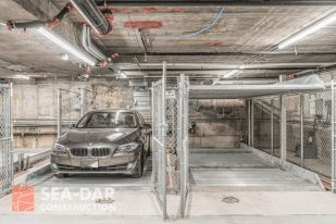Behind the scenes cables installed beneath the concrete give this underground garage its stability.