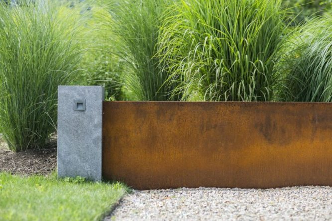 Aging beautifully amidst the seaside conditions, Cor-Ten steel was introduced as a low maintenance material to contrast with the Alverson limestone veneer. Photography by Neil Landino