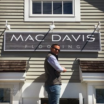 Mac Davis putting the finishing touches on the company's new Osterville showroom.