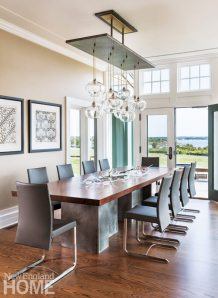 The design-savvy wife worked closely with furniture maker Jeff Soderbergh in devising the perfect dining table for crowds; the hand-blown glass branches are by Jamestown, Rhode Island's Clancy Designs.
