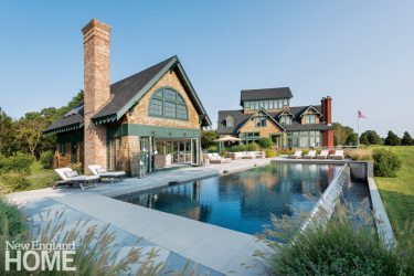 """Landscape architect Katherine Field designed a herringbone bluestone surround for the negative-edge pool and used bluestone to marry the pool destination with the main house. """"Angled bluestone paving aligns with the house geometry and brings all the geometries together,"""" she says."""