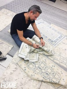 The man behind the company is Jakub Staron, seen here doing some quality control on rug samples.