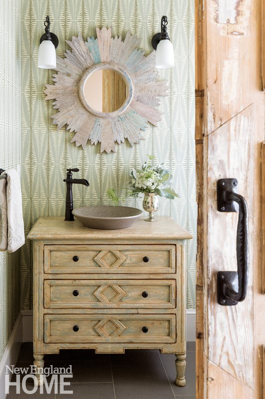 Powder room with wooden vanity