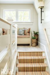 Landing area on stairs with window seat