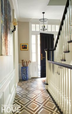 The entry's tile floor packs a punch, rivaled only by the sinuous new staircase installed where the original would have sat.
