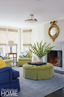 The family room's kiwi-colored furnishings bask in light from newly expanded rear windows.