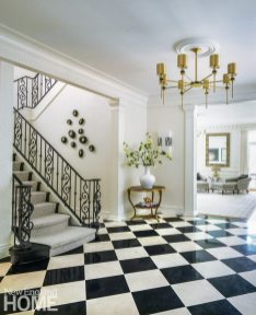 Foyer with wrought-iron banister and marble floor