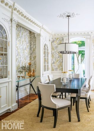 Dining room with crown molding and monkey wallpaper