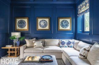 A cherry-paneled media room was painted blue