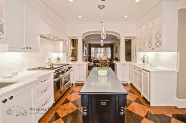 White kitchen with stained checkerboard floor