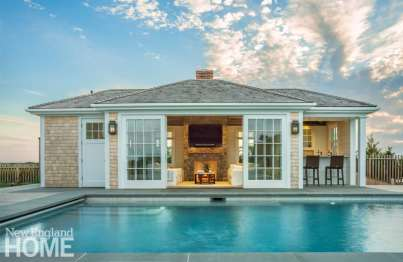 The pool house doors open wide to let in fresh air and sun; an inviting sitting area turns any gathering into a party.