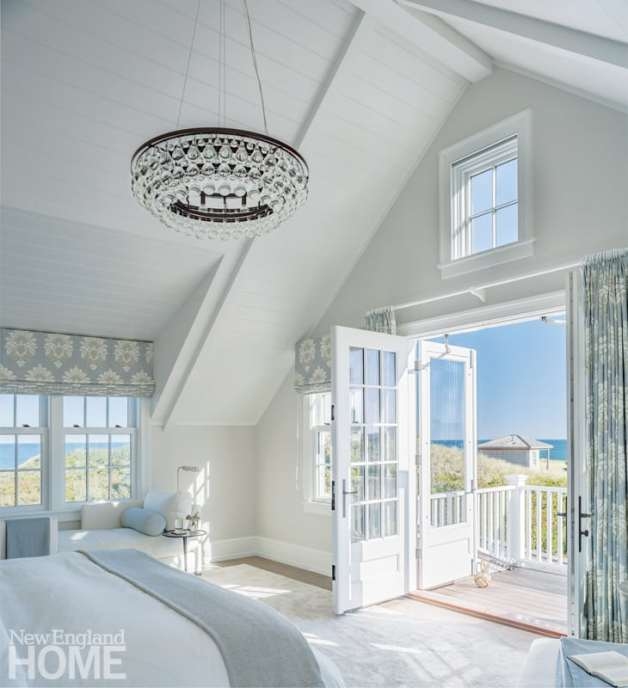 The airy master bedroom with its attached porch plays up the expansive views of the coastal dune and the beach and ocean beyond.