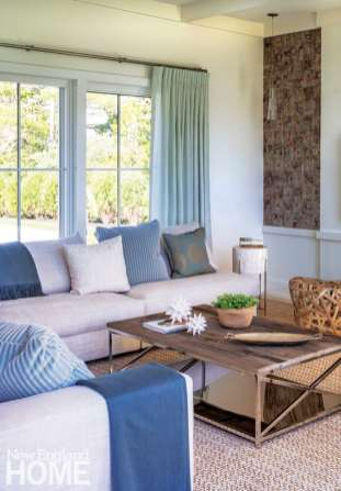 Among the few exceptions to the home's neutral palette are the minty blues designer Jennifer Palumbo introduced to the living room.