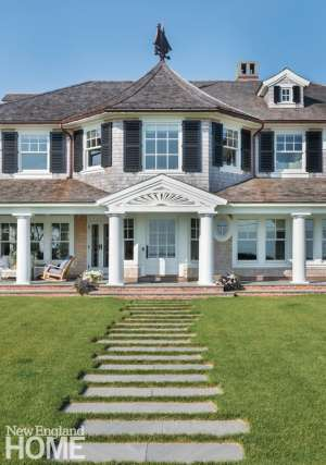 Exterior shingle style home with weathervane