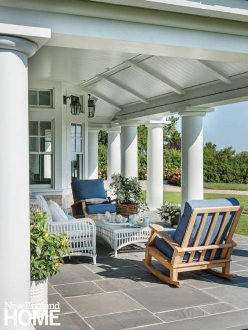 Exterior shingle style home with porch