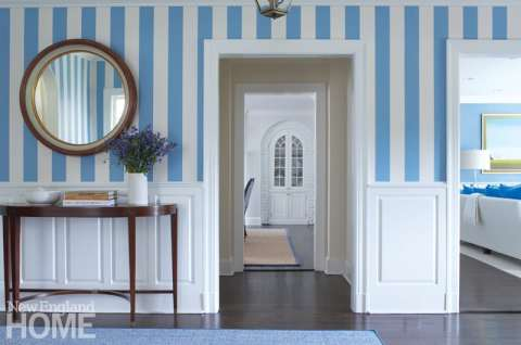 Entryway with blue and white striped wallpaper