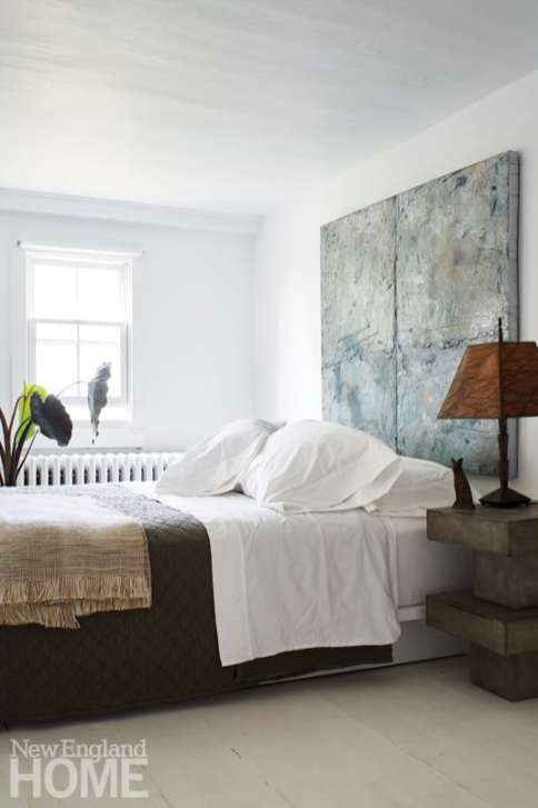 Guest room with a painting as the headboard