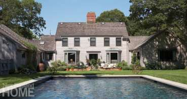 Exterior Royal Barry Wills Colonial with pool