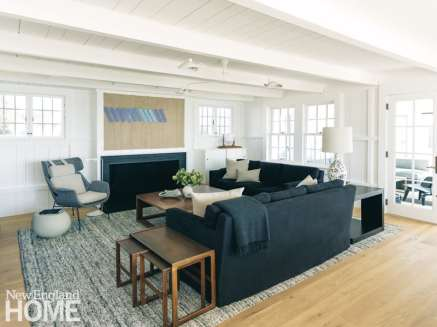 Living room with dark blue linen sofa