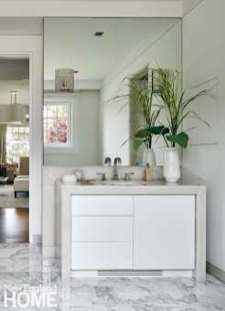 White vanity with alabaster frame
