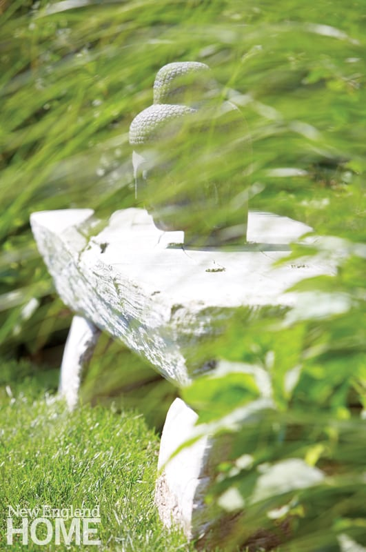 A carved Buddha—a present from Gaelle Dudley's mother, who also happens to be a sculptor—brings a personal note to the garden.