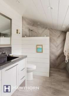 The bathroom was wrapped in shiplap to add both texture and durability.