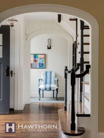 The elegant lines and neutral palette found in the home's entryway set the tone for the homes updated traditional look.