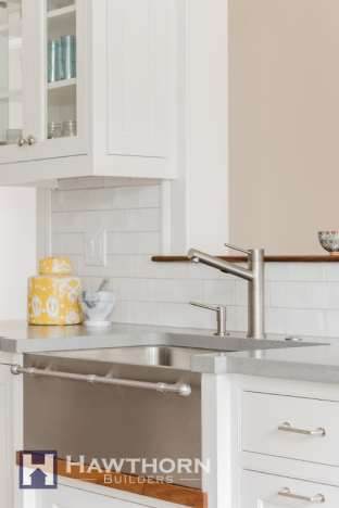 A Blanco sink with incorporated towel bar is an elegant addition to the kitchen.