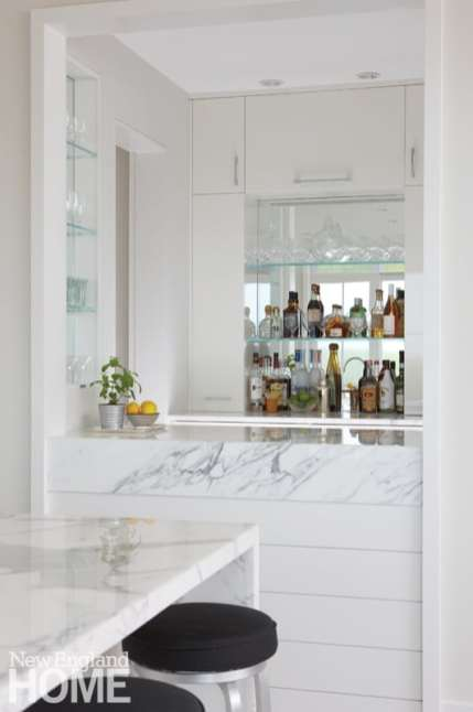 Contemporary Nantucket bar and laundry area