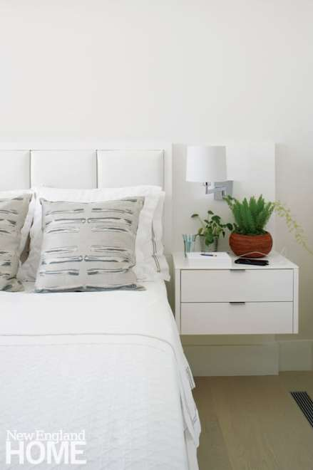 White bed with built-in nightstand