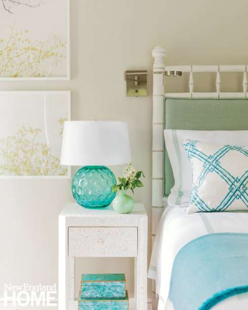 A bamboo-inspired bed gives a hint of the tropics to a guest room.