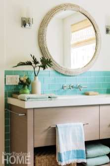 Aqua Ann Sacks oversize glass subway tiles form the backsplash in the master bathroom.