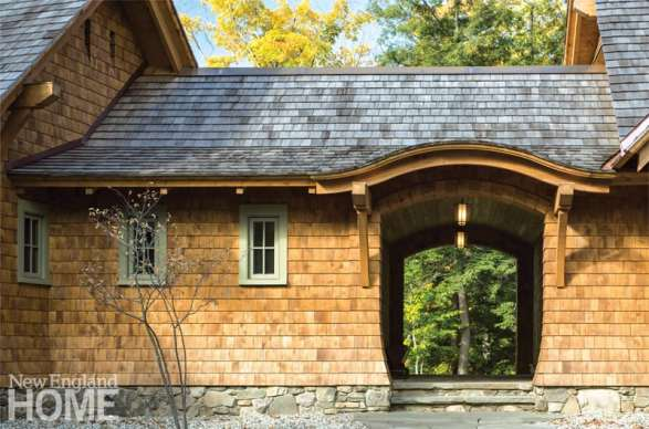 Vermont shingle style home eyebrow arch