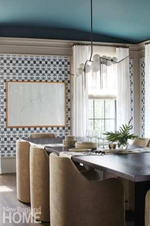 """""""The dining room's focus is the wallpaper,"""" explains designer Kristine Irving, who also chose Farrow & Ball's Inchyra Blue paint for the ceiling."""
