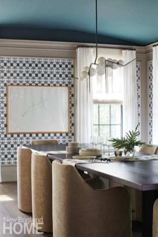 """The dining room's focus is the wallpaper,"" explains designer Kristine Irving, who also chose Farrow & Ball's Inchyra Blue paint for the ceiling."