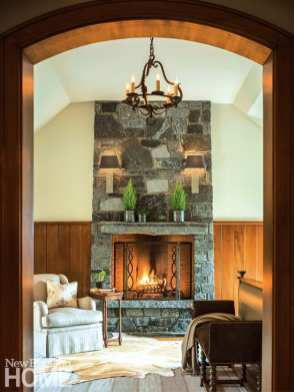 A fireplace warms the master bedroom's sitting area.