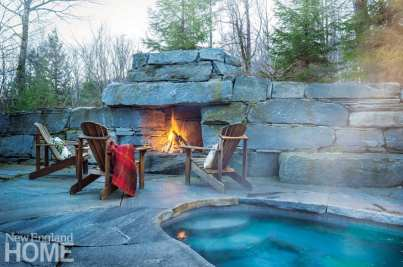 With its fireplace and hot tub, the upper level's rear patio is a favorite spot to warm up and relax sore skiing muscles.