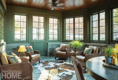 An octagonal screened porch became a winter room with glazing and radiant heat under the floor and behind the granite wainscoting.