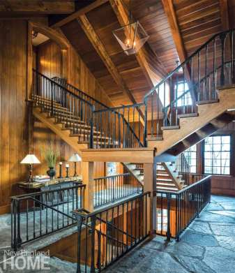 The treads of the central staircase change from stone to wood as they ascend.
