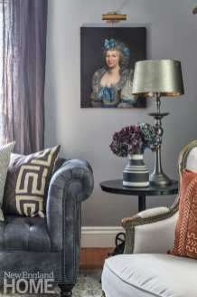 antique portraits, living room, family room, chesterfield sofa, African-print pillows