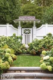 A up-close look at the white gate on the exterior of the home