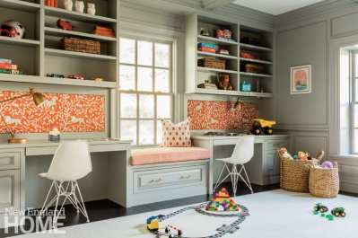 Homework room is painted light gray with orange and white patterned accents